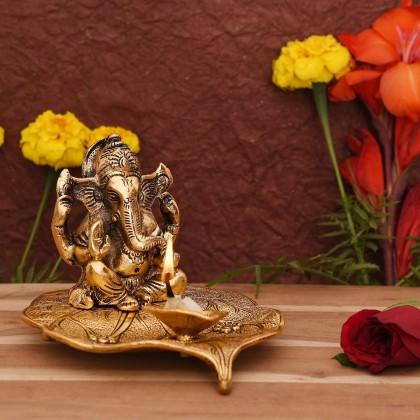 Ganesh Idol on Leaf - Lord Ganesha with Diya - Metal Hand Craved for Home Decorative